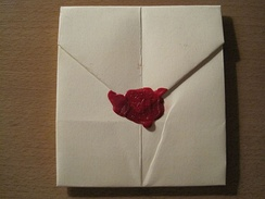 "Hand-folded letter sealed with wax and stamped with capital letter ""A"". If a letter is folded and sealed correctly, a wax seal can eliminate the need for an envelope as demonstrated in the above picture."