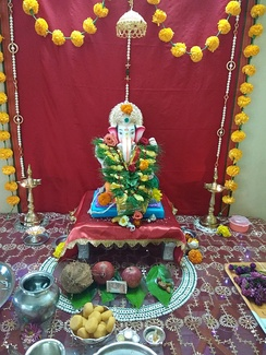 A domestic celebration of Ganesh during Ganesh Chaturthi in a Maharashtrian home