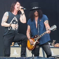 Slash and vocalist Myles Kennedy performing with the Conspirators in June 2015