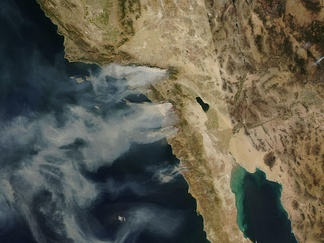 The California wildfires of October 2007 burn in Hunter's congressional district seen in this satellite NASA photo