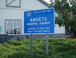 "All of I-90 within New York is designated as the ""AMVETS Memorial Highway"", as indicated by this sign at the Port Byron service area.[6]"
