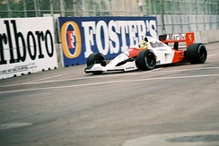 A picture of Ayrton Senna driving a McLaren MP4/6 formula one car during the 1991 United States Grand Prix.