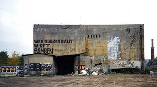 WWII bunker near Anhalter Bahnhof (Berlin) with a graffiti inscription Wer Bunker baut, wirft Bomben (those who build bunkers, throw bombs)
