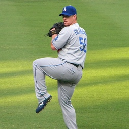 Billingsley warming up before a game against the Atlanta Braves
