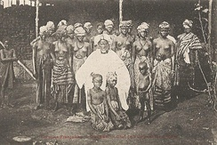 Village chief and his wives in Guinea, c. 1910