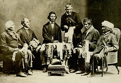 Chiefs of the Six Nations explaining their wampum belts to Horatio Hale, 1871