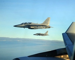 Two FA-50 Golden Eagle light multi-role fighter/trainer jets escorting a Philippine Airlines flight carrying President Benigno S. Aquino III