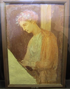 Roman fresco of a blond maiden reading a text, Pompeian Fourth Style (60–79 AD), Pompeii, Italy