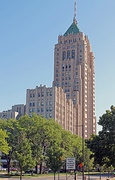 The Fisher Building, is designed in an Art Deco style, faced with limestone, granite, and several types of marble.