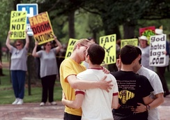 Students kissing in front of protesters from Westboro Baptist Church at Oberlin College in Ohio