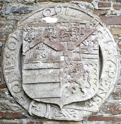Heraldic escutcheon of General George Monck, 1st Duke of Albemarle (1608–1670) on external wall above the private doorway to north transept of parish church of St Giles-in-the-Wood, Devon