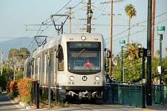 "Los Angeles' expansion of mass transit has been driven in large part by light rail. The Metro Gold Line (now ""L Line"") is pictured above."