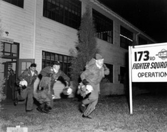 Pilots from the 173rd Fighter Squadron, 155th Fighter Group, Nebraska Air National Guard, running to their planes during a practice alert at Lincoln Air Force Base, Nebraska (USA), before 1953, when the unit was redesignated Fighter Interceptor Squadron.