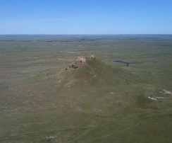 Much of western South Dakota is covered by grasslands and features buttes such as Thunder Butte, shown above.