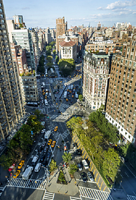 X-shaped intersection of Broadway (from lower right to upper left) and Amsterdam Avenue (lower left to upper right), looking north from Sherman Square to West 72nd Street and the treetops of Verdi Square