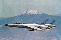 A USAF F-105F trainer and a F-105D with Mount Fuji in the background