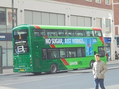 A First Leeds bus seen on the Headrow in 2018 in the new green livery