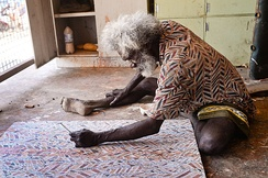An Australian Aboriginal artist at work