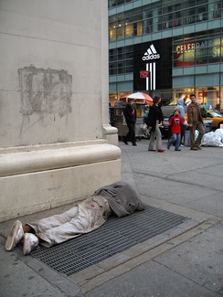 Juxtaposition of homeless and well off is common on Broadway, New York City