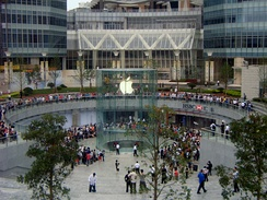 Apple aficionados wait in line around an Apple Store in Shanghai in anticipation of a new product.