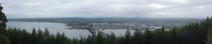 Panorama of Inverness from the Black Isle, with Moray Firth to the left and Kessock Bridge in the center