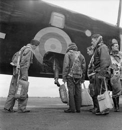 35 Squadron Halifax crew climbs aboard in preparation for a mission over the continent