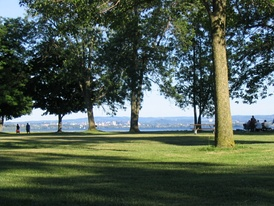 Onondaga Lake Park in the northern suburbs of Syracuse. Picture captures Onondaga Lake with the Syracuse skyline in the background. Onondaga Lake Park attracts over one million visitors each year.