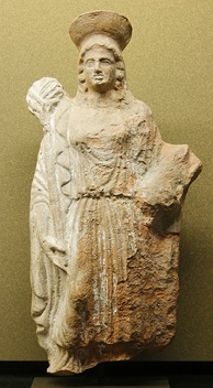 Female figure carrying a torch and piglet to celebrate rites of Demeter and Persephone (from Attica, 140–130 BCE)