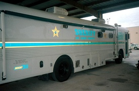 St. John's County (FL) Command Center bus (1980s Blue Bird All American), curbside view