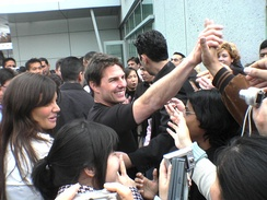 Cruise and Katie Holmes interacting with fans in March 2006