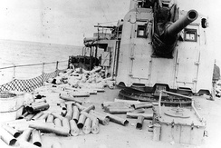 Expended cartridge cases and powder tanks from the ship's 5-inch/38 caliber guns litter the deck, after firing in support of the Normandy invasion off Utah Beach, 6 June 1944. This view was taken on the ship's afterdeck, with mount 54 at right.