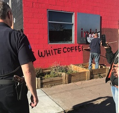 Clean up effort by the City of Denver at ink! Coffee in Five Points, Denver.  The coffee shop was vandalized following the debut of a controversial ad campaign.