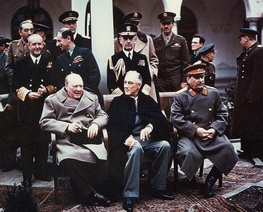 From left to right: Winston Churchill, Franklin D. Roosevelt and Joseph Stalin. Also present are Soviet Foreign Minister Vyacheslav Molotov (far left); Field Marshal Sir Alan Brooke, Admiral of the Fleet Sir Andrew Cunningham, RN, Marshal of the RAF Sir Charles Portal, RAF, (standing behind Churchill); General George C. Marshall, Chief of Staff of the United States Army, and Fleet Admiral William D. Leahy, USN, (standing behind Roosevelt)