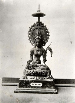 Ancient statue of Dewi Sri from Java (c. 9th century)