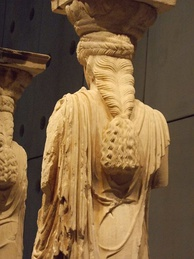 Intricate hairstyle of caryatid, displayed at the Acropolis Museum in Athens