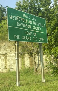 "Signs welcoming motorists into Nashville on major roadways include the phrases ""Music City"" and ""Home Of The Grand Ole Opry""."