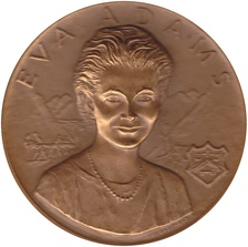 Mint Director Eva Adams, seen here on her medal (designed by Gasparro) was instrumental in the issuance of the Kennedy half dollar.