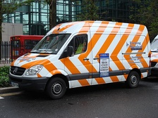 The Evening Standard has a fleet of delivery vans painted in a distinctive orange and white livery