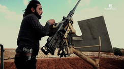 A rebel fighter from the FSA loads a U.S.-made M2 Browning heavy machine gun in northern Aleppo, November 2016