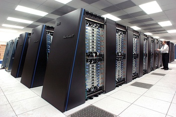 """The IBM Blue Gene/P supercomputer """"Intrepid"""" at Argonne National Laboratory runs 164,000 processor cores using normal data center air conditioning, grouped in 40 racks/cabinets connected by a high-speed 3-D torus network.[1][2]"""