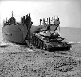 A Crusader I tank emerges from the Tank Landing Craft TLC-124, 26 April 1942.
