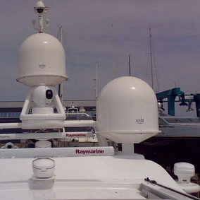 A yacht fitted with small KNS tracking dishes for SES Broadband for Maritime, protected by radomes