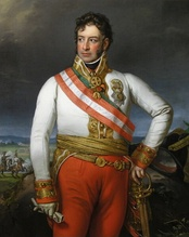 Painting of an overweight man with his left hand on a sword hilt and his right hand holding a glove. He wears a military uniform consisting of a white coat and red breeches with a red and white sash across his shoulder and a gold sash around his waist.