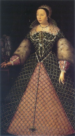 "Catherine de' Medici, as queen of France. ""Her mouth is too large and her eyes too prominent and colourless for beauty"", wrote a Venetian envoy as Catherine approached forty, ""but a very distinguished-looking woman, with a shapely figure, a beautiful skin and exquisitely shaped hands"".[33]"