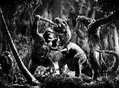 Promotional image featuring Kong battling and killing the Tyrannosaurus.