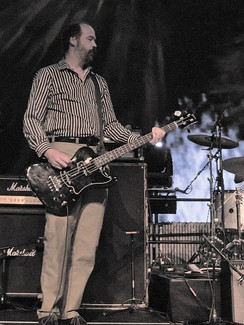 Novoselic playing bass guitar on stage
