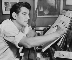 Bernstein at the piano, making annotations to a musical score