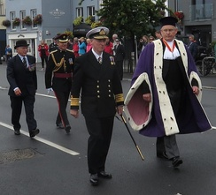 Bailiff Richard Collas (right) attending the Queen's birthday parade 2016 in his formal robes