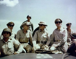 Kenney (left, with sunglasses), Richard Sutherland, Sergio Osmeña and Douglas MacArthur off Leyte, October 1944.