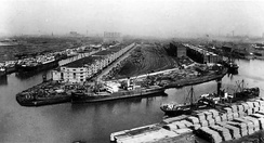 The opening of the Salford Docks turned Salford into a major inland port along the ocean-going Manchester Ship Canal. This site is now occupied by The Lowry.
